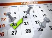 Calendar with push pins marking dates