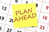 """""""Plan Ahead"""" sticky note on calendar page"""